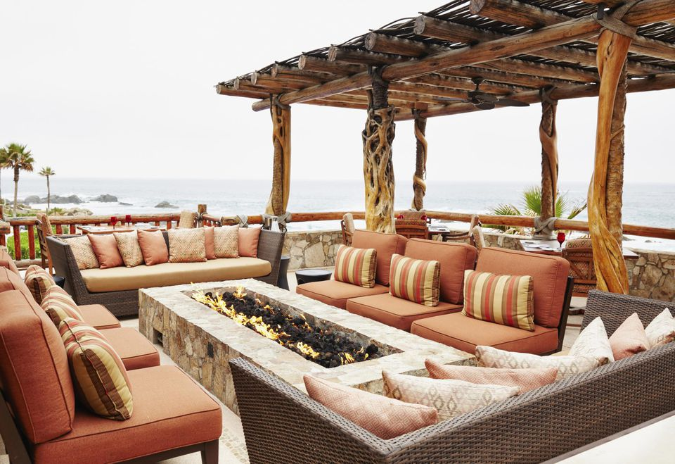 Fire pit and sofas on resort patio