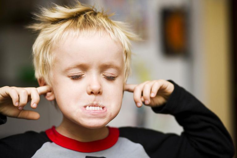 Child with fingers stuck in his ears