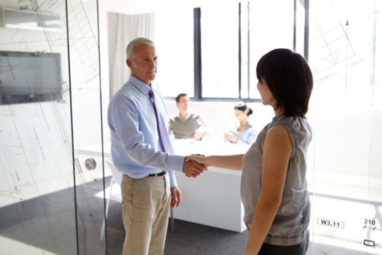 Businessman shaking hands with female colleague
