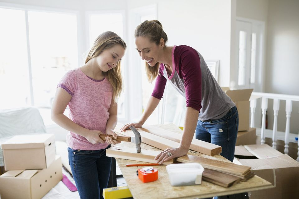 A picture of a mom and daughter redecorating