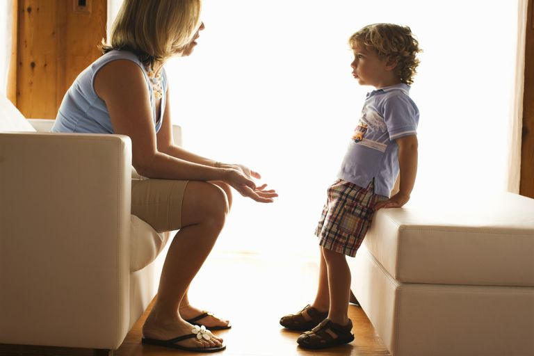 Mother talking seriously with young son