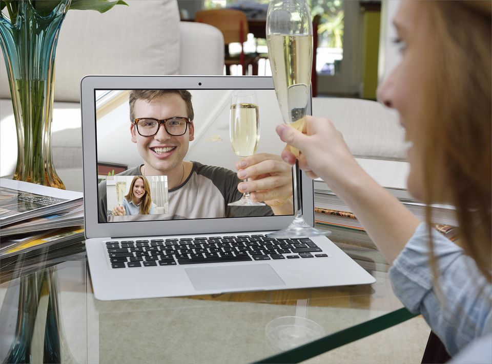 Celebrating with Champagne over Skype