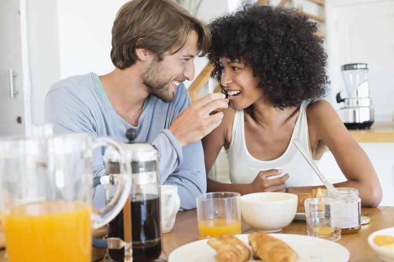 Man feeding food to her partner