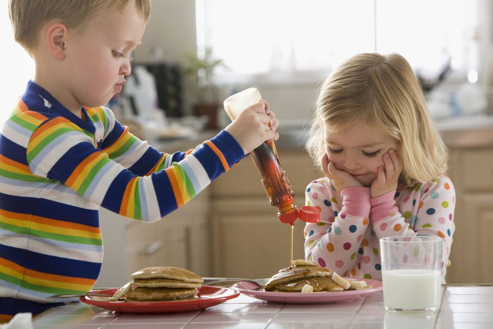 Siblings eating pancakes