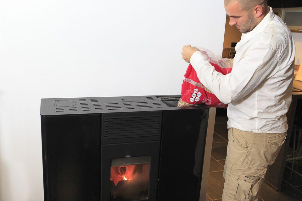 France, man filling a stove