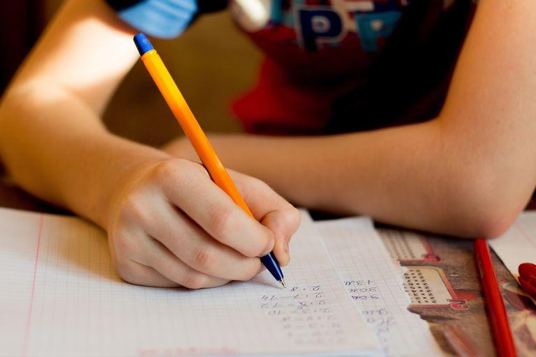 Cropped Image Of Boy Doing Homework