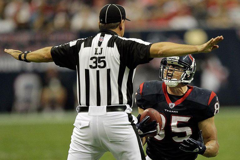 Tight-end Joel Dreessen #85 of the Houston Texans pleads with line judge John Hussey.