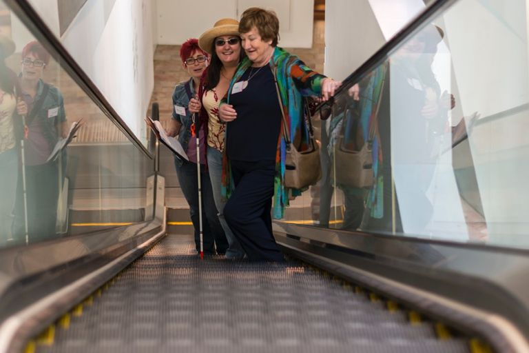 sighted guide on escalator
