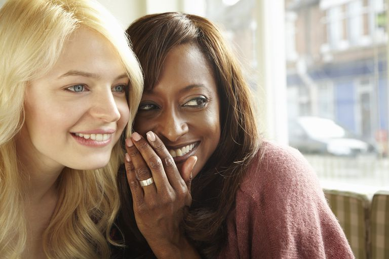 Two Women Whispering in Cafe
