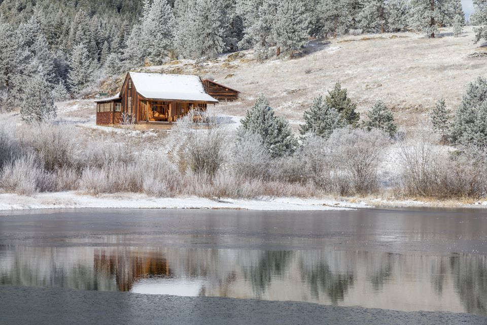 photo of a snow-dusted cabin in the park during winter