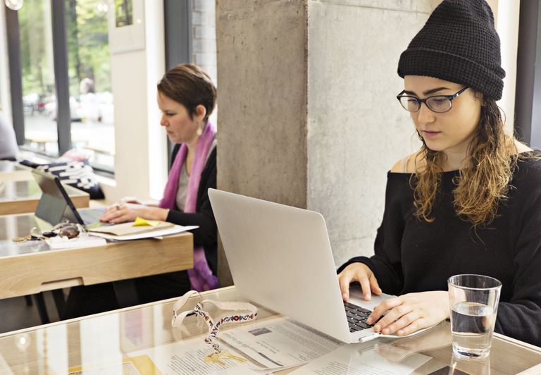 Women working on laptops in cafe
