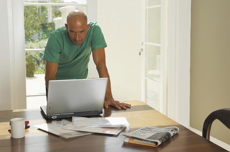 Man at home using laptop