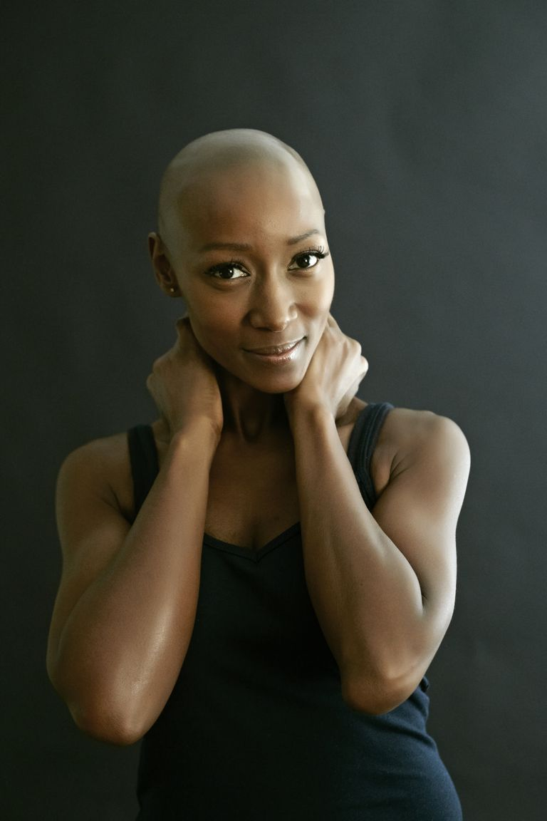 African American woman smiling and bald