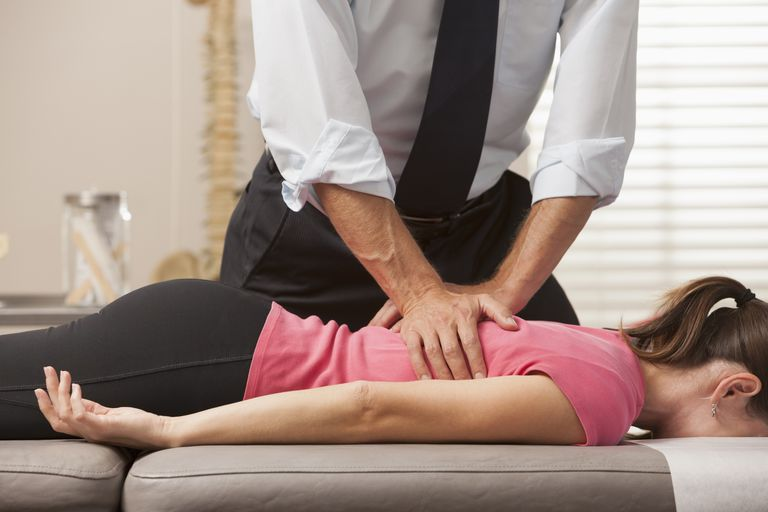chiropractor treating female patient