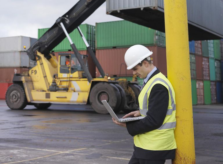 Port Workers With Laptop And Containers