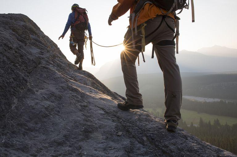 Two climbers climbing mountain