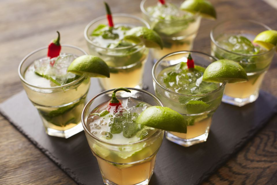 Chilli vodka cocktail garnished with lime wedges