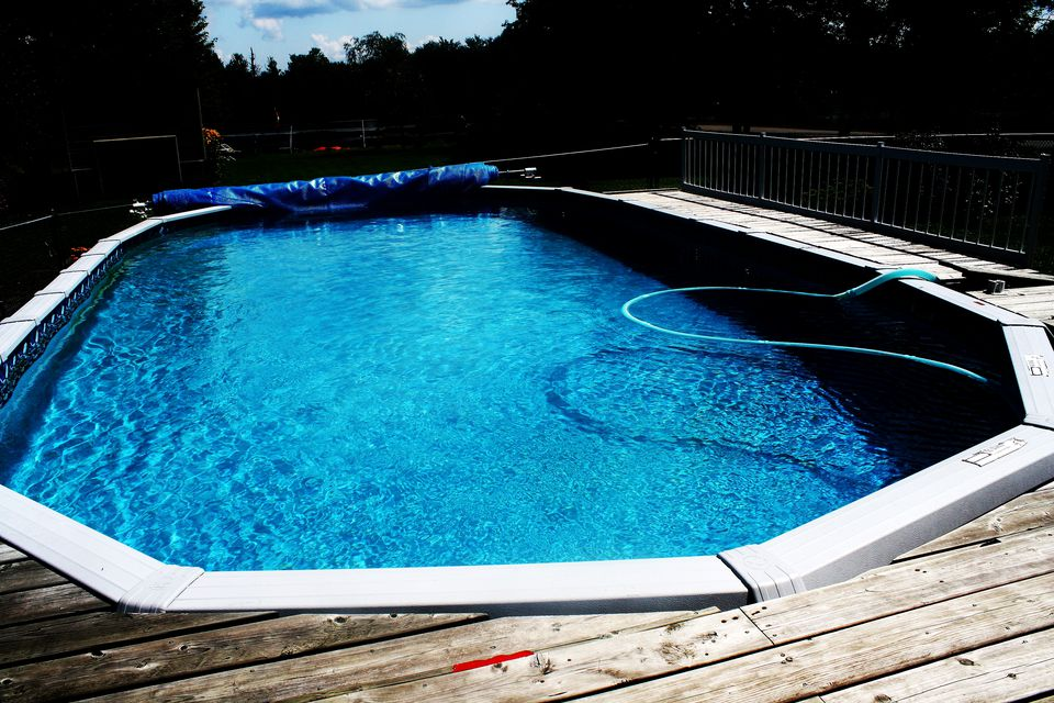 Above ground swimming pools designs shapes and sizes for Above ground pool siding ideas
