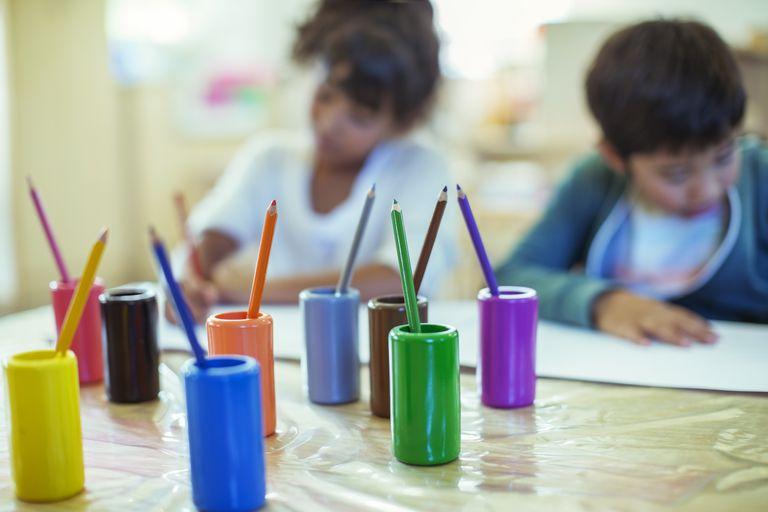 Colored pencils on desk in classroom