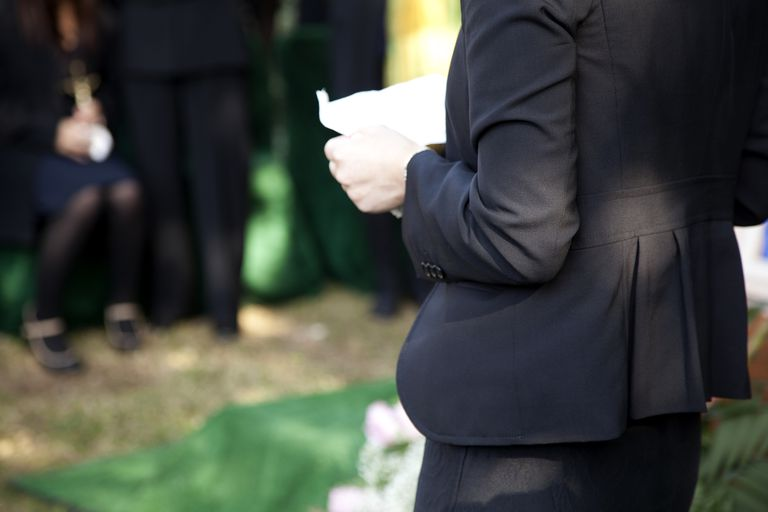 person giving eulogy at funeral