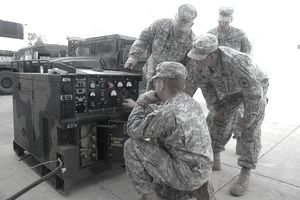 B-231st BSB Annual Training 626/North Dakota Army National Guard Soldiers who serve as power generation equipment repairers with Company B, 231st Brigade Support Battalion, check the gauges on a 10K generator as they run a load bank on the machine.