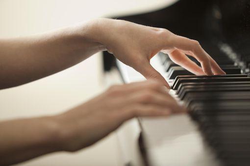 USA, Utah, Lehi, Young woman hands playing piano
