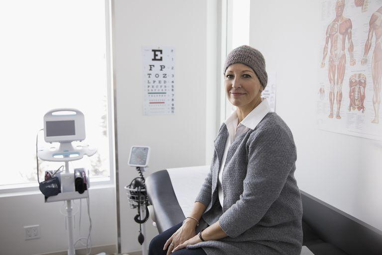 woman in doctor's office wearing a hat