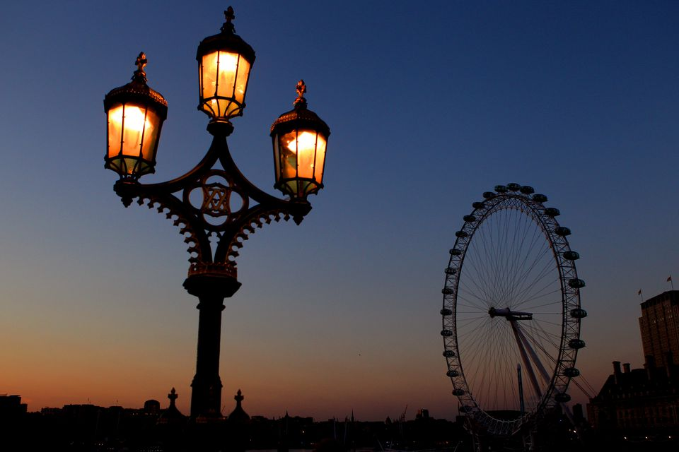 London lamps and London Eye Ferris Wheel at dusk