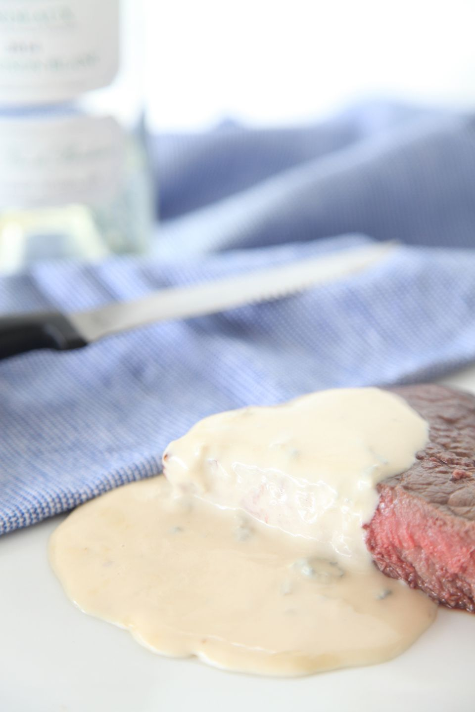 A close-up of blue cheese sauce on steak