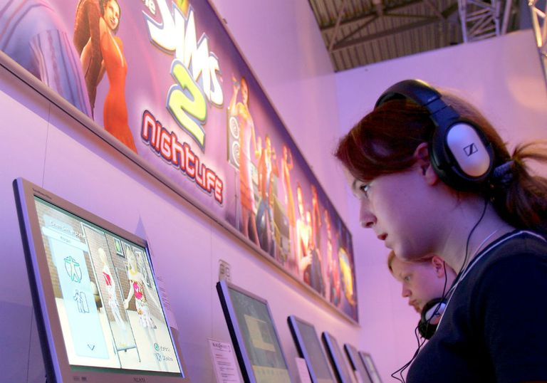 Woman playing Sims 2