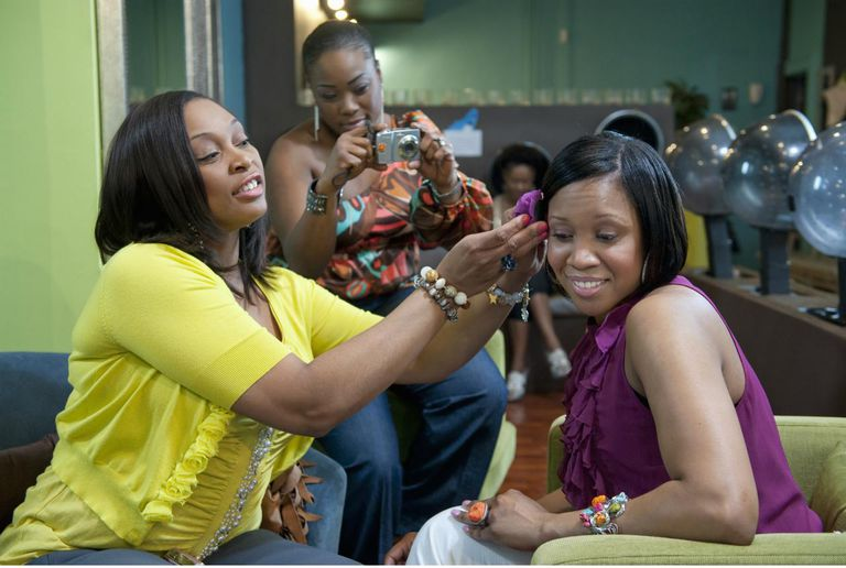 Women at beauty salon getting ready for a relaxer touch-up.