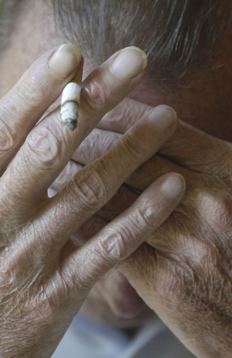 senior man smoking