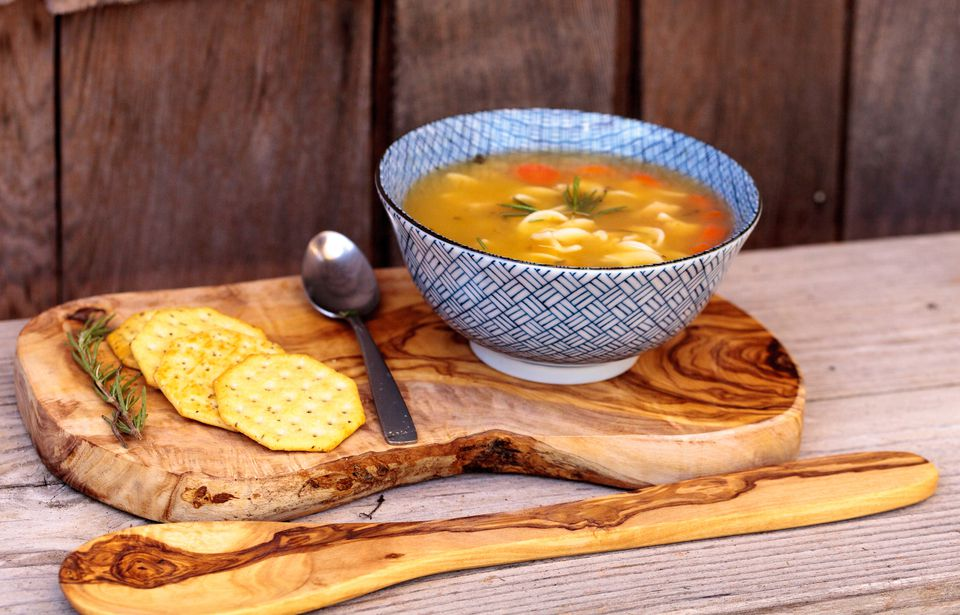 chicken noodle soup served with crackers
