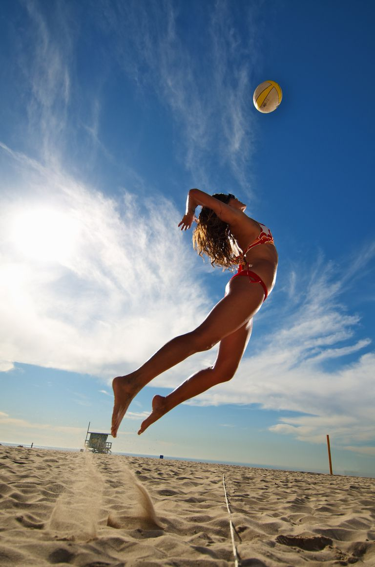 Woman serving a volleyball