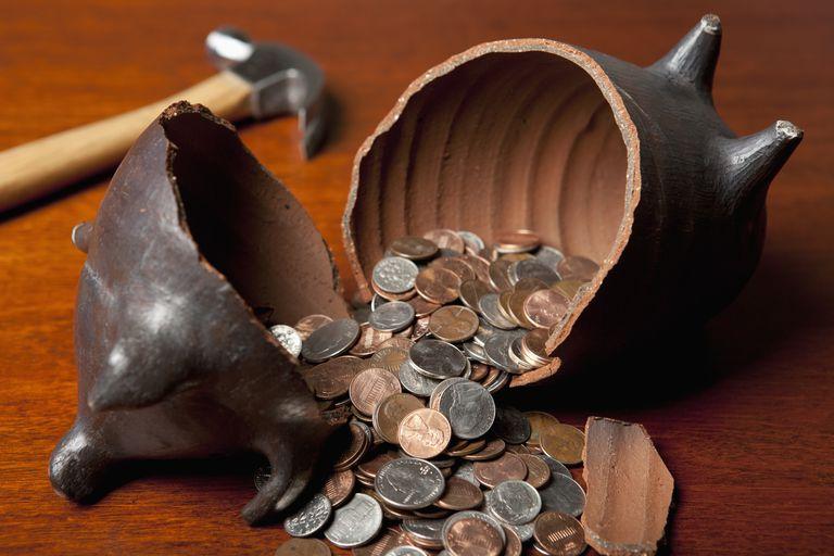 Piggy bank broken open by hammer
