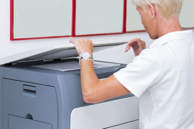 Nurse at work...using photocopier,copiing medical results