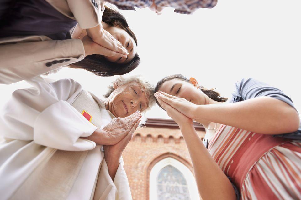 Girl and mom praying at church