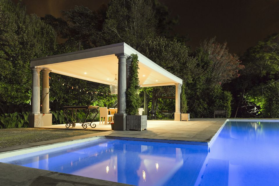 Illuminated gazebo at poolside