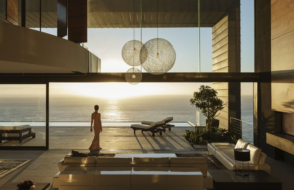 woman in a house overlooking the ocean