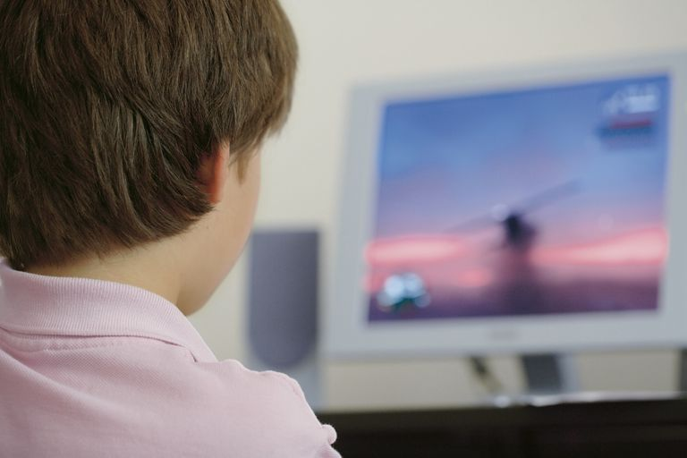 Boy playing PC game