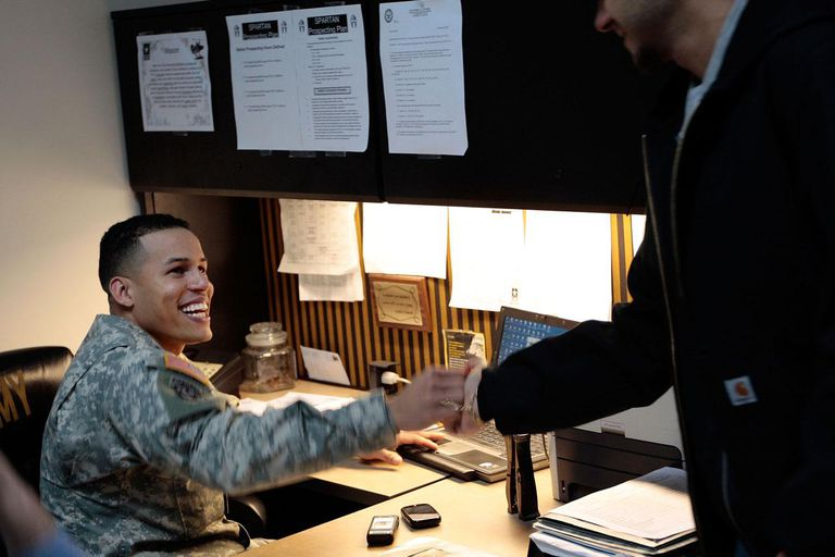 NEW YORK - DECEMBER 17: Army recruiter Staff Sgt. Pablo Valdez Martinez (L) smiles as he greets a potential Army recruit in the new office for the City Hall Recruiting Station December 17, 2009 in lower Manhattan in New York.