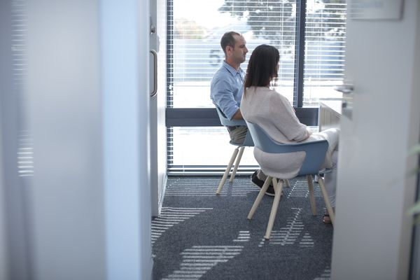 Couple sitting in consulting room at the doctor s