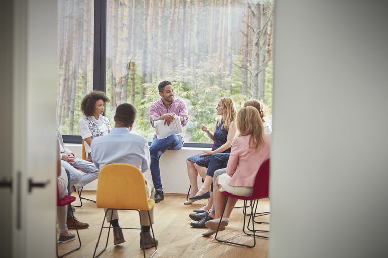 Woman talking in group therapy session