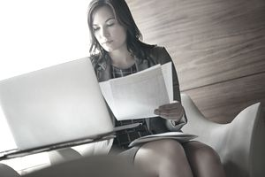 Business woman with laptop and papers