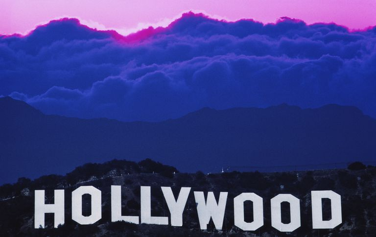 USA, California, Los Angeles, sun behind clouds over Hollywood sign