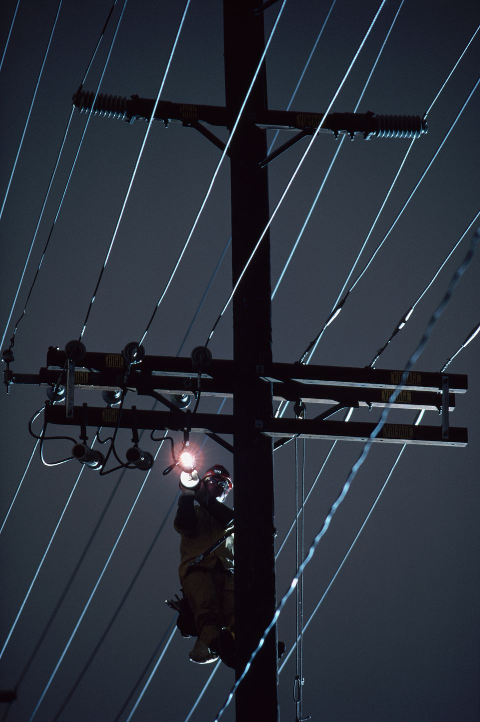 Lineman Throwing Switch on Utility Pole