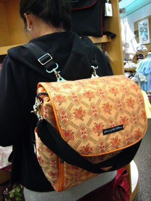 Give mom gifts that make her look pretty like a fashion diaper bag