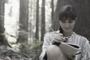 A writer working outdoors