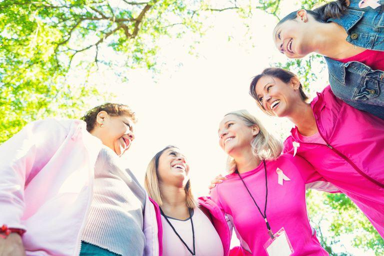 Diverse team huddled before breast cancer awareness race