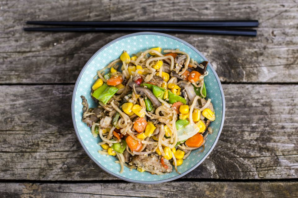 Vegetarian stir-fry with noodles, corn, carrots, mushrooms, sprouts and tofu